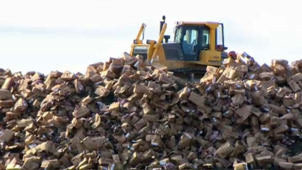 Boxes of beef from XL Foods are dumped in the landfill.