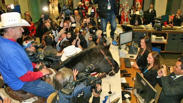 Stamps fans and Marty the Horse are shown some Western hospitality at BMO Bank of Montreal's headquarters in Toronto. (Photo Courtesy: BMO)