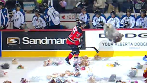After scoring in the first period, Pavlo Padakin returns to the bench through a maze of stuffed animals
