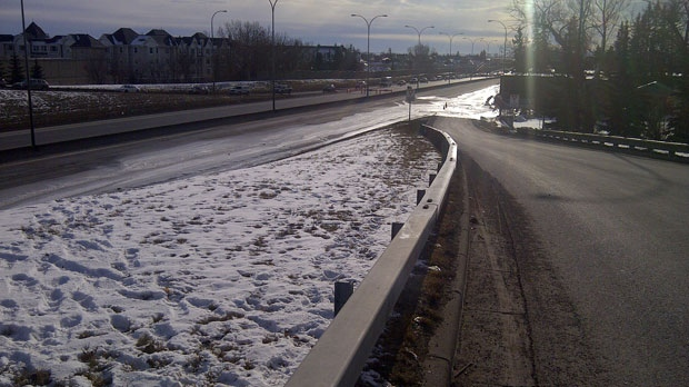 Ice covers the curb lane of southbound Crowchild Trail just south of the 33 Ave overpass.