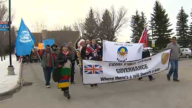 Thousands of protesters rally at Harper's office