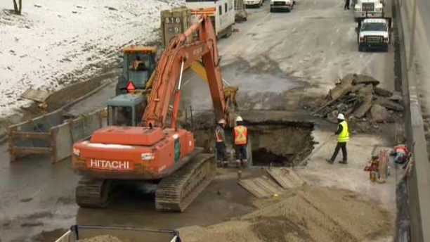 All three lanes of Crowchild Trail were closed so crews could excavate.