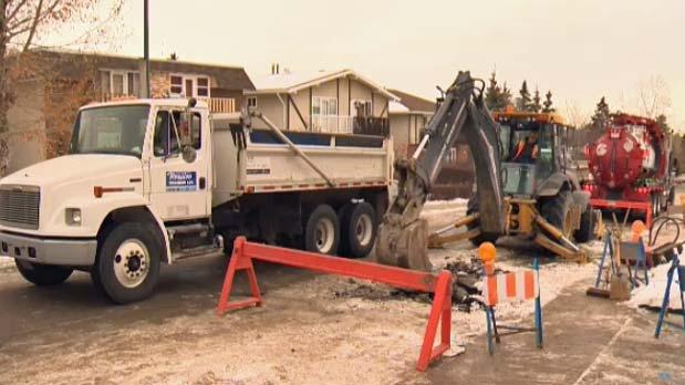 Crews cut through a Marda Loop street
