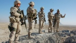 Canadian troops stand atop an observation post in Folad, Afghanistan, Nov. 23, 2010. (Murray Brewster / THE CANADIAN PRESS)