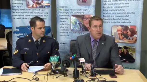Greg Bass, Superintendent of Schools and RCMP Cpl. Darrin Turnbull address the media on Friday, Dec. 14, 2012.