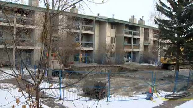 A huge hole has been dug in front of the Cedars of Calgary apartment complex.