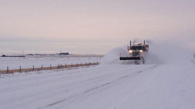 A plow clears off a section of Highway 567 northeast of Calgary on Saturday, December 22, 2012