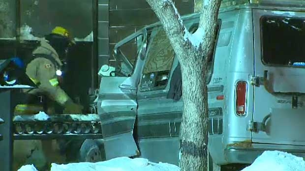 Fire crew attend the scene of a van that slammed into the side of a building in southwest Calgary.