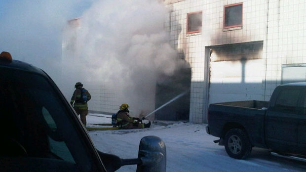 Firefighters battle the flames inside of a Brandon Street business