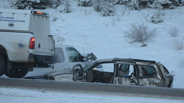 Two severely damaged vehicles, a GMC Envoy and a Sheriff Transport van, sit in the ditch of the Trans-Canada Highway near Scott Lake Hill following a fatal Thursday morning collision. (Photo Courtesy:   James Bundy Photography)