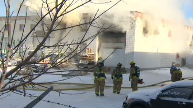 Fire crews survey the scene of a Thursday afternoon fire at a business complex on Brandon Street