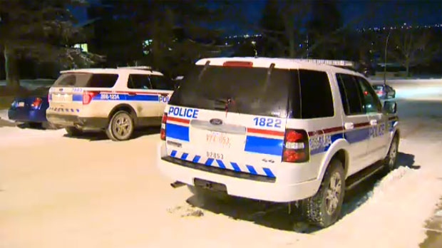 Police vehicles parked outside of a Parkland home following reports of a man suffering a gunshot wound
