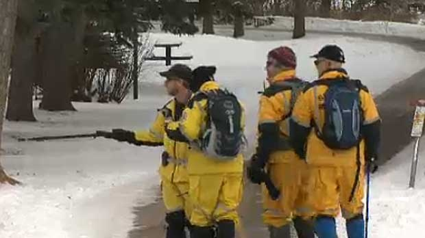 Search and rescue volunteers search Edworthy Park for any trace of Sandra Mykytiuk-Evans, who has been missing since Saturday.