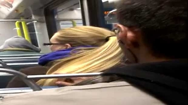 A screen capture of from a video making the rounds on social media shows a man touching the hair of an unidentified woman on the CTrain. The video is now in the hands of the police.
