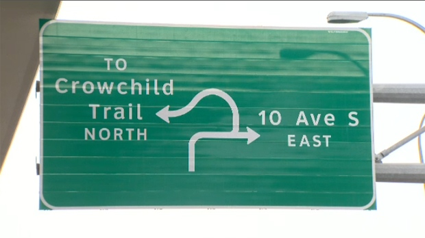 A sign illustrating the traffic route connecting eastbound Bow Trail with northbound Crowchild Trail