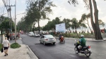 Tourist and traffic make their way along Patong Beach road in Phuket, Thailand, Friday, Dec. 23, 2005.