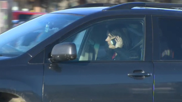 A driver in northeast Calgary is seen talking on her cellphone while behind the wheel.