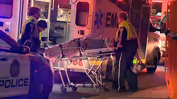 Paramedics assist injured man