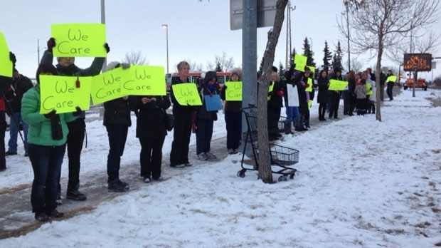 Residents of Sandstone gather to support the family of a woman killed in a hit and run last week. Police are still looking for the second driver.