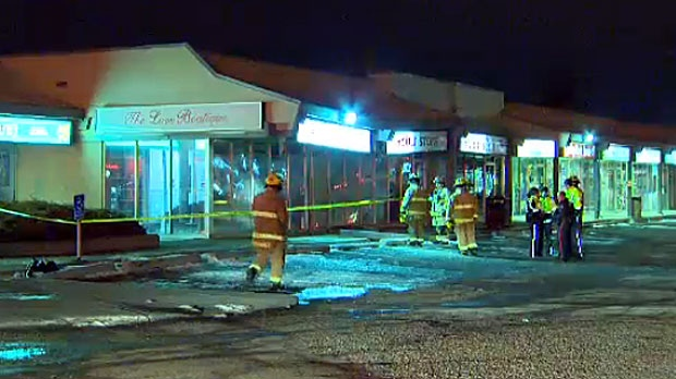 Driver crashes into strip mall