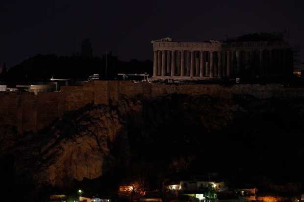The Parthenon temple stands atop the Acropolis hill after turning off the lights to mark the annual Earth Hour in Athens, on Saturday March 23, 2013. (AP / Kostas Tsironis)