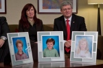 Darcie Clark's cousin Stacy Galt, left, sits with Prime Minister Stephen Harper in this February 2013 before he announced the Conservative government's plan to provide courts with new powers to lock up people found not criminally responsible for their crimes due to mental problems. Darcie Clark's children Max, Cordon and Kaitlynne were killed by her ex-husband Allan Schoenborn in Merritt, B.C. in 2008. (Darryl Dyck/THE CANADIAN PRESS)