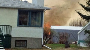 Fire threatens homes on Bowdale Crescent N.W.