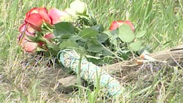 Flowers are laid at site of crash on Highway 3