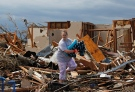 <b>75 Photos: Devastating Damage After Tornadoes Strike</b><br><br> After a monstrous storm ripped through Oklahoma and Kansas, the search for survivors continues and residents begin to sift through the devastation. <br><br> Kandi Scott salvages items from the rubble of her home, which she shared with her mother, until it was destroyed Monday when a tornado moved through Moore, Okla., Tuesday, May 21, 2013. (AP / Brennan Linsley)