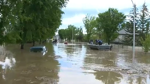 The RCMP have searched over 3,000 homes in High River on June 24, 2013, finding 303 people and numerous pets still holding out in their homes. Now that they're gone, the town will begin plans to re-enter the flood-stricken community.