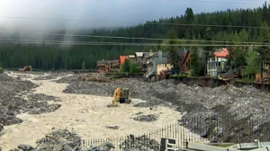 Crews work to rebuild Cougar Creek in Canmore.