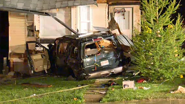 The SUV crashed into the houses and sparked a fire.