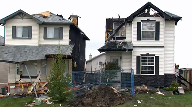 Two homes were heavily damaged by the crash and fire.
