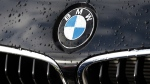 In this March 19, 2013 file photo the company logo of car manufacturer BMW is pictured on a car in Munich, Germany.  (AP / Matthias Schrader, File)
