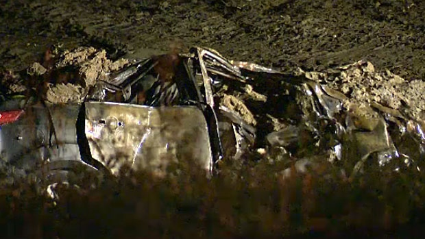 A car is seen lying in the ditch alongside Highway 63 with extensive damage after it was involved in a crash with a semi truck that lost control. Six people are now recovering in hospital.