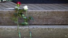 Flowers left by mourners rest on the front step of Jack Layton's Toronto home in condolence of Layton's passing Monday.