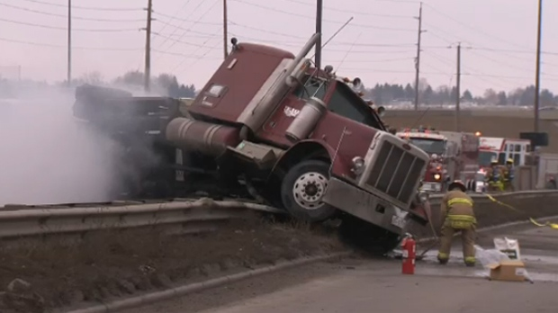 CFD members on the scene of Thursday afternoon's crash involving a semi on Glenmore Trail