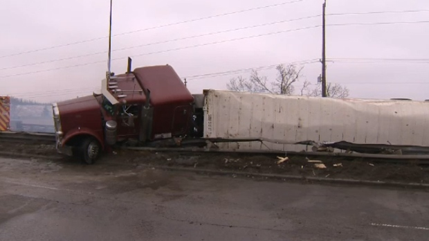 A semi trailer on its side following an afternoon crash on Glenmore Trail