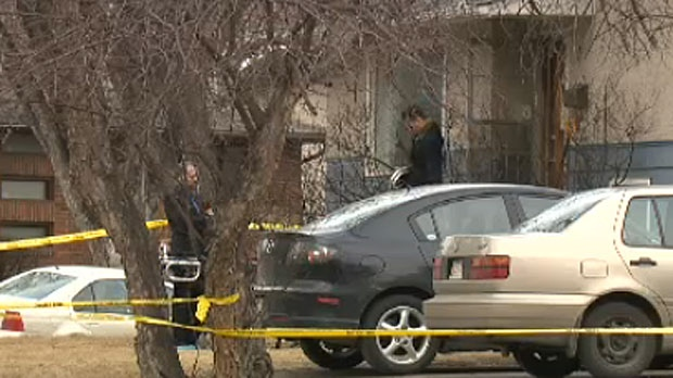 Homicide detectives are seen outside a home in Brentwood on April 15, 2014, following a multiple stabbing that has claimed the lives of five young people.