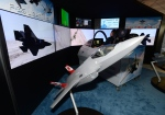 Lockheed Martin displays an F-35 simulator at the CANSEC trade show in Ottawa on Wednesday, May 28, 2014. (Sean Kilpatrick / THE CANADIAN PRESS)