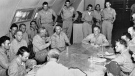 In this Aug. 6, 1945 file photo made available by the U.S. Army, the crew of the Enola Gay is debriefed in Tinian, Northern Mariana Islands after returning from their mission over Hiroshima, Japan.
