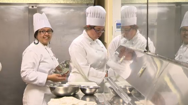Students in the pilot project at SAIT prepare the food for their graduation ceremony