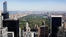 Central Park and buildings in midtown Manhattan are seen from the Rainbow Room, New York City's landmark restaurant atop 30 Rockefeller Plaza, Sunday, Oct. 5, 2014. (AP Photo/Mark Lennihan)