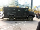 A police tactical truck winds through downtown Ottawa. (Richard Madan/CTV News)
