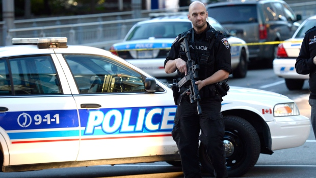 A police officer patrols a street in Ottawa on Wednesday, Oct. 22, 2014. (Adrian Wyld / THE CANADIAN PRESS)