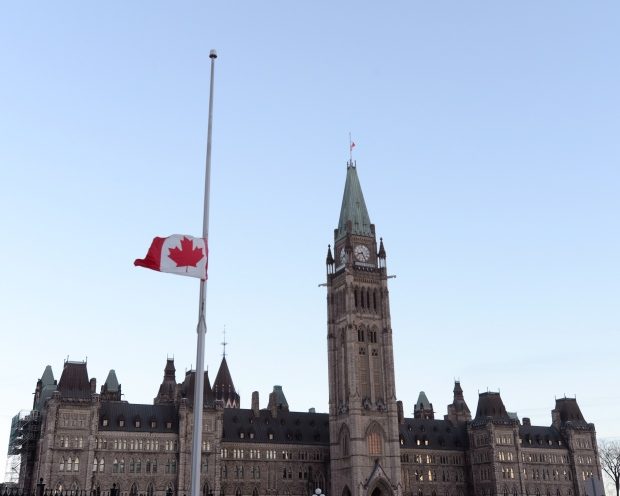 Flags fly at half mast on Parliament hill and on the Peace Tower in Ottawa on Thursday, Oct. 23, 2014. (Sean Kilpatrick / THE CANADIAN PRESS)