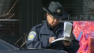 A CPA officer issues a ticket in the downtown core