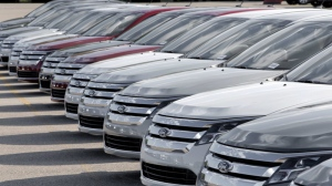 Ford Taurus' are shown on a dealership lot in Sterling Heights, Mich., Monday, Aug. 31, 2009. (AP Photo/Paul Sancya)