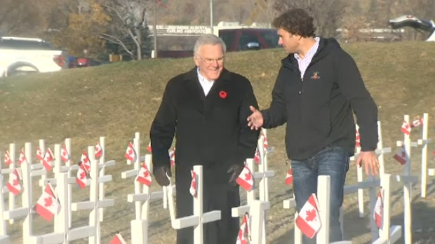 Murray McCann and David Howard walk through the sea of crosses