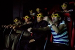 In this Sept. 22, 2013 photo, North Koreans ride on an amusement park ride while watching a 3D movie at the Rungna People's Pleasure Park in Pyongyang, North Korea. (AP Photo/David Guttenfelder, File)